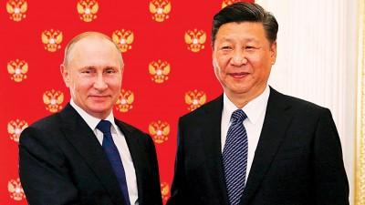 习近平(右)和普京(左)于克里姆林宫会面,就是朝鲜半岛局势、敍利亚当问题交换看法。(法新社照片)