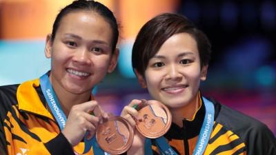 里约奥运会跳台银牌组合潘德蕾拉/张俊虹于女双10米台摘铜牌,凡是我国以布达佩斯游泳世锦赛的首迎奖牌。