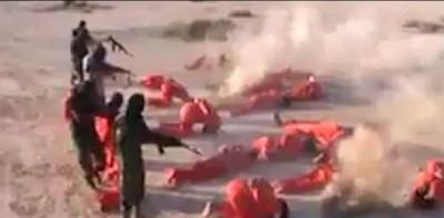 利比亚国民军的刽子手抓到IS成员后,于相同处空地集体枪决IS成员。