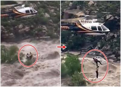 救救人员游绳而下,救出受困登山者。