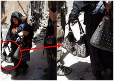 妇女是IS的自杀式炸弹袭击者,她当时手上拿着的是一个引爆器(红圈示)。