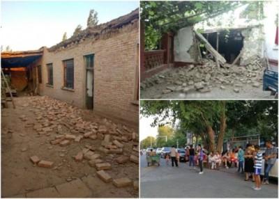 震造成建筑物损毁,万众也到户外暂避。(网上图片)