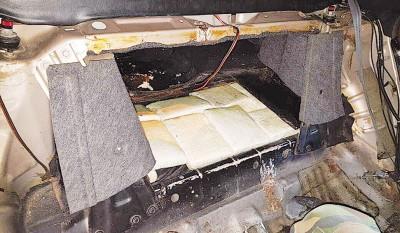 毒犯改装轿车后座运毒也难逃法网。