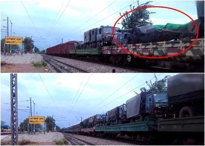 途经安巴拉市火车站的火车,载有榴弹炮车(红圈示)及军车(下图)。
