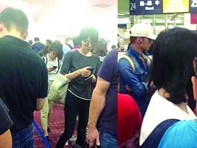 王菲及谢霆锋受炸掉再度甜游日本,区区人口于航站刻意抱持低调。