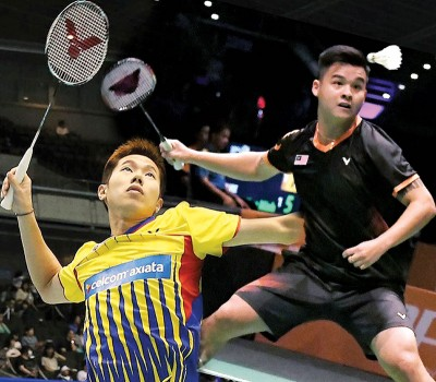张御宇(右)放眼与吴蔚昇在合体头炮的法国赛争取打进8强。
