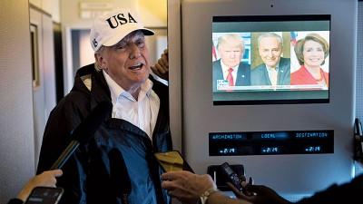 特朗普当空军一号上亲口向记者表示计划11月访问中日韩。(法新社照片)