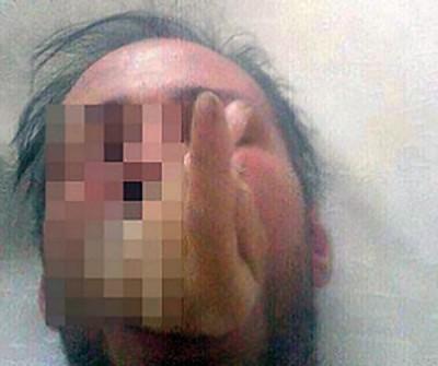 手机中照片,一颗人头口中竟然塞著一只断掌。