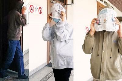 虽获释但不代表无罪,3被告一如往常,穿上外套用报纸遮盖脸部,一前一后离开法庭避开媒体镜头。