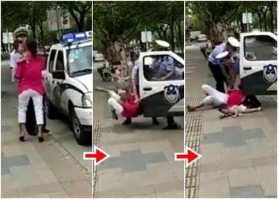 警员将手抱孩子的妇人摔倒地上,被外界批评过度使用武力。