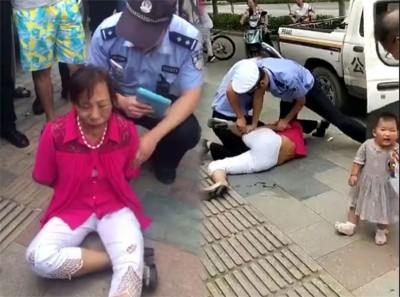 妇人因违例泊车后与警员争执,最后被警员制服。