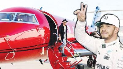 英国的F1车王汉密尔顿(右)当社交媒体中时时展示的那么架价值1650万英镑的红巴迪挑战者605。