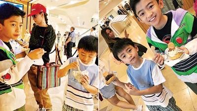 张柏芝带着2个儿子一同逛街。