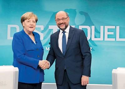默克尔同舒尔茨(右)拿于下月重新就是组阁会