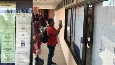 民众踊跃询问PNG情况。告示牌上通知PNH车牌开始接受招标申请。