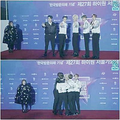 SJ脱下外套替主持人披上后,挤一起抱紧取暖。
