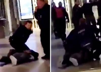 男子中枪后倒地,被警员制服。