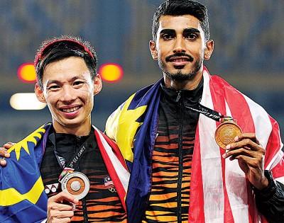 李合伟(左)与瑙拉治星。