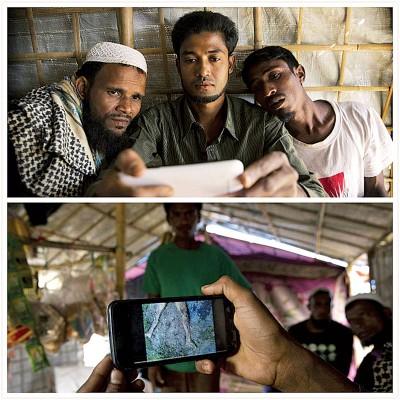 卡林(上图中)向友人展示手机拍下的尸体影像。