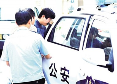唐男受公安部扣押。