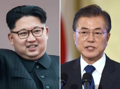 金正恩(左)和文在尊重(右)定于下月召开首脑会谈。(法新社照片)