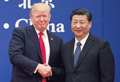 特朗普盛赞习近平(右)是个伟大的人,还称自己到访中国时受到礼遇。