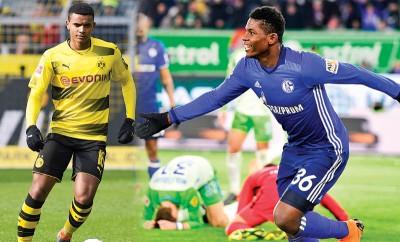 (左)瑞士后卫阿坎吉。(右)瑞士前锋恩博洛。