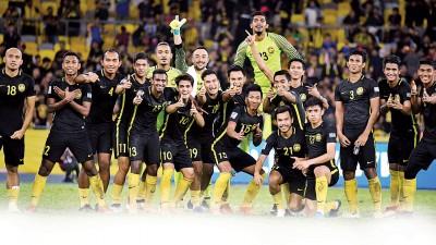 国足最终迎来久背的胜利。