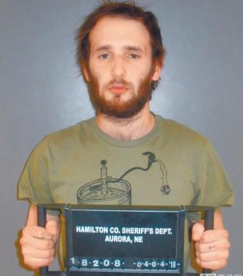 哈波被捕后在警局留下档案照。