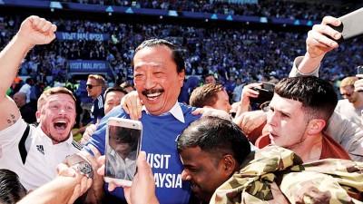 马来西亚籍老板陈志远欣慰卡的那个升级。