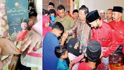 吉州行政议员陈国耀全程陪同大臣派发青包予出席孩童,但并没留意小孩手上是否有盖章。(左)拿青包盖卡通印章纯粹是让孩童开心。