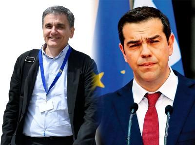 (左)希腊财长萨卡洛托斯。(左)总理齐普推斯邪在2015年,为此一度扬止要退沒欧元区。(法新社照片)