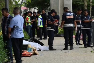 警方鉴证组人员到场检查遭肢解的不明遗体。