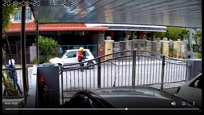 匪徒犯案过程已被附近住家电眼摄下。