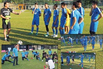 王金瑞(上图左)在球场上与球员进行最后的备战。哈米丁(蓝色格子衫)看好国青打进淘汰赛。