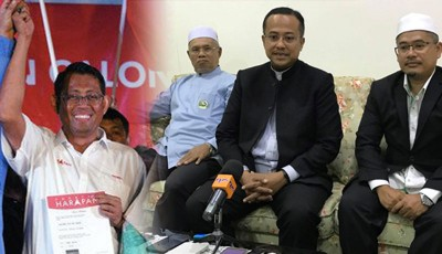 (左)可望盟候选人哈利米(右)阿末三苏里(倍受)以记者会上登讲话,右为阿末法古鲁丁当人口陪伴。