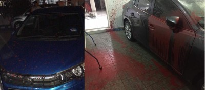 王氏男子停放庭院及屋外的轿车受波及,车身尽是红漆。