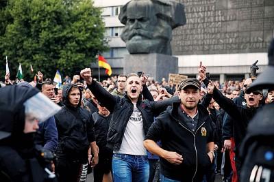 当地人被杀引发反移民冲突。(法新社照片)