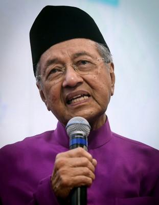马哈迪:开明接受多数人决定。