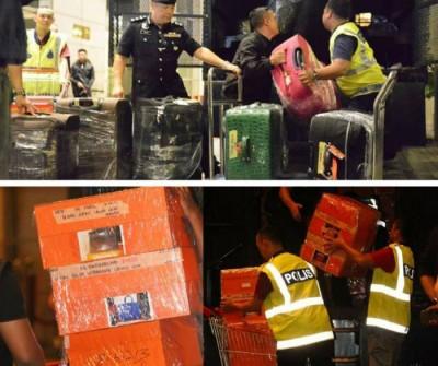 警方曾检举与纳吉有关的高级公寓,把装有284个名牌手提包的盒子运走调查。