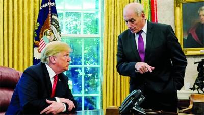 凯利(右)称特朗普不打算兴建水泥围墙。
