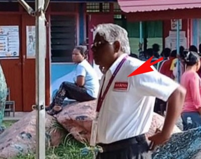 希盟候选人马诺嘉兰被网民拍摄到身穿印有政党标志的衣服进入投票站。