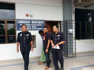39岁主嫌是遭谋杀者姆廉尼的继姐夫,左1为 副警区主任沙惹里。