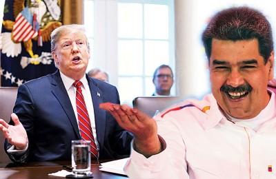 特朗普(左)批评马杜罗(右)挡美国为委内瑞拉提供的人道物资。(法新社照片)