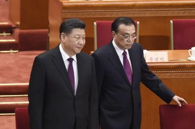 习近平(左)跟李克强共进场。(法新社照片)